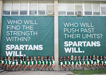 Spartan pompon team under Spartans Will banner