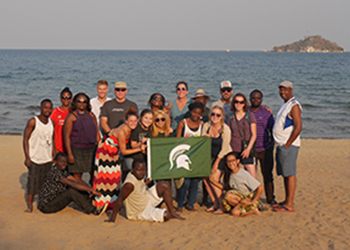 Malawi team in front of the beach