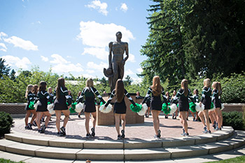 The MSU Pompon team gathers around the Sparty Statue