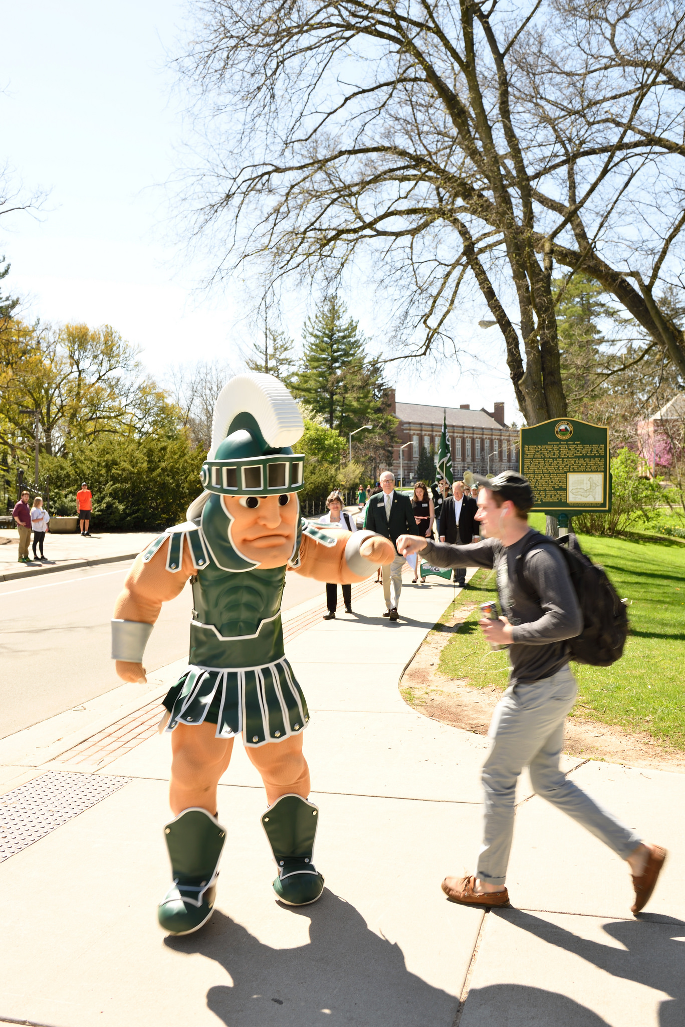 Sparty and students on campus