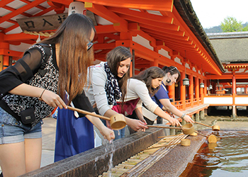 Students participating in a traditional Japanese ceremony