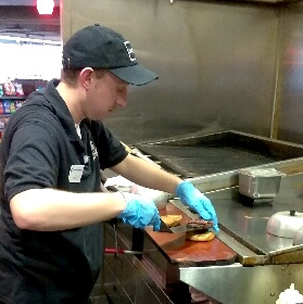 Kyle works the grill at Vista