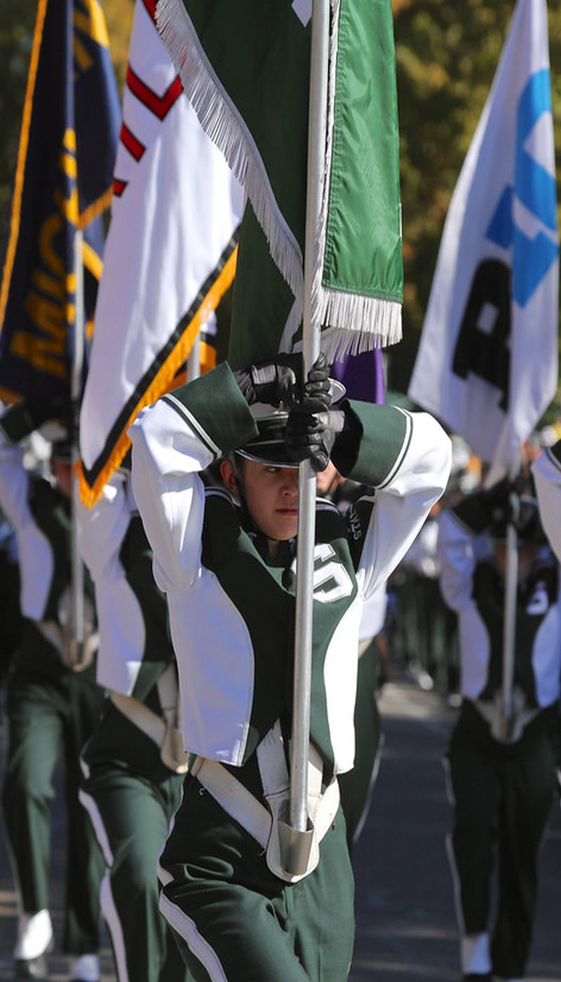 A Spartan Marching Band Member with their flag