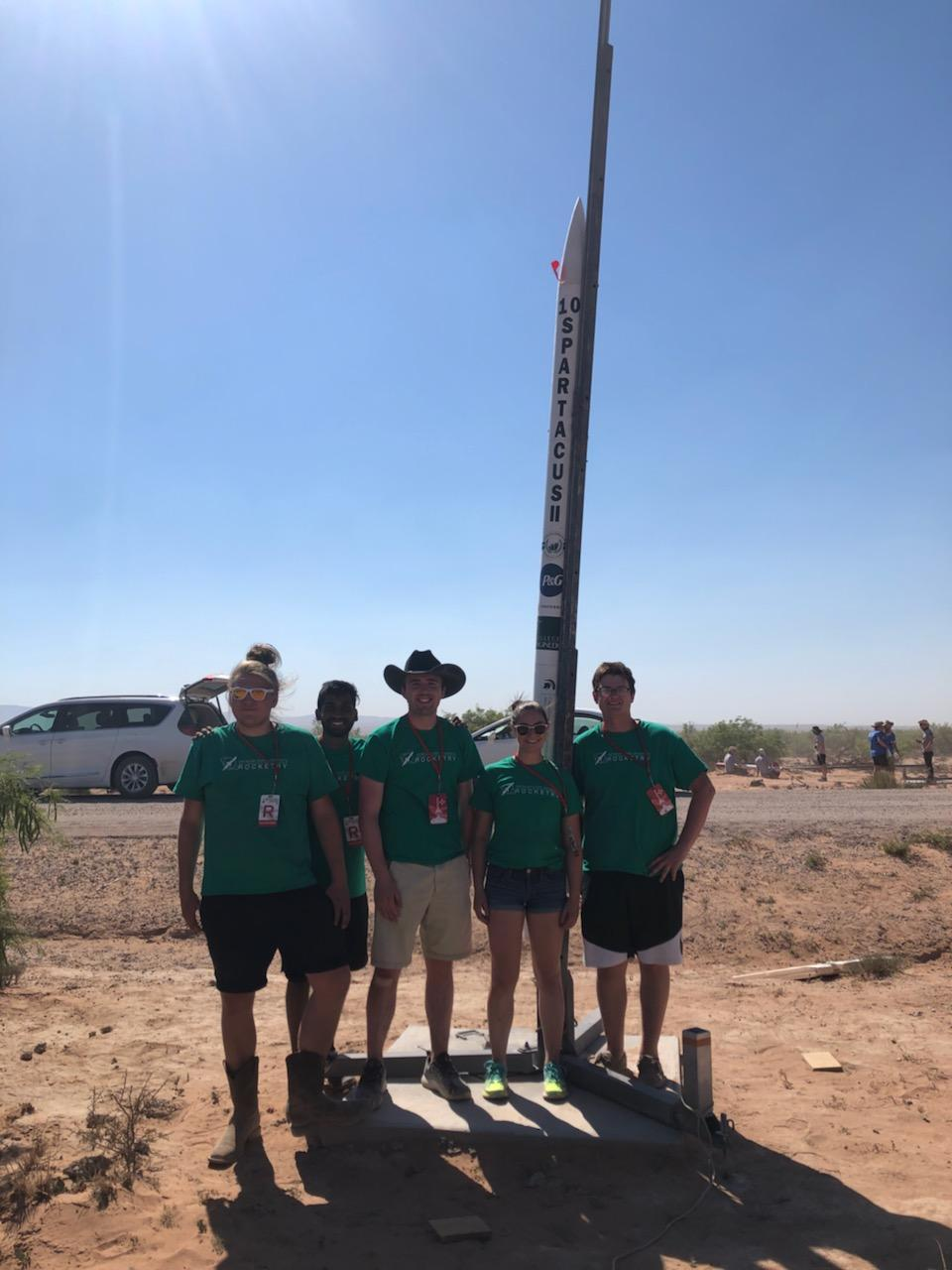 Members of the rocketry team in front of their newest rocket