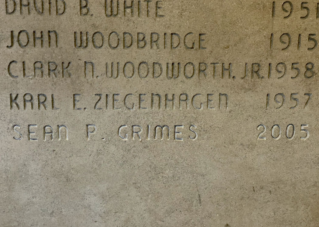 Image of a head stone featuring the names of fallen Spartan veterans, including Captain Sean Grimes.