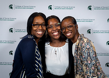 WLI panelists smiling at an event.