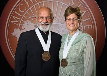 Shashi and Margaret Gupta pose with their award medallions