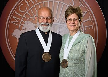 Shashi and Margaret Gupta pose with their award medallions