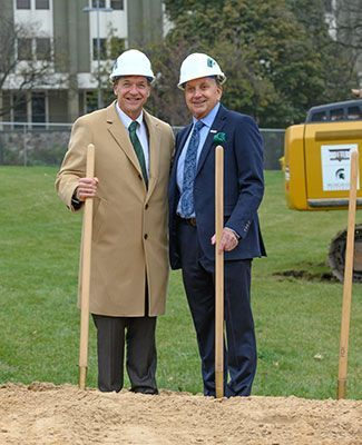 President Stanley poses with Doug Meijer and some shovels at the groundbreaking