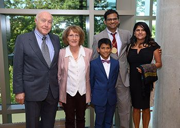 John and Eva Cillag pose with Arun Ross and his family