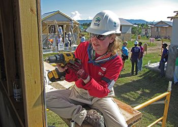 Sandra Pearson, '92 (Eli Broad College of Business) works on constructing a home.