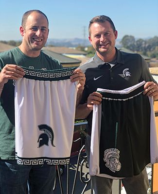 Aaron Loomer, '02 (Agriculture and Natural Resources) and Chad Amo, '02 (Communication Arts and Sciences) with their Spartan basketball shorts