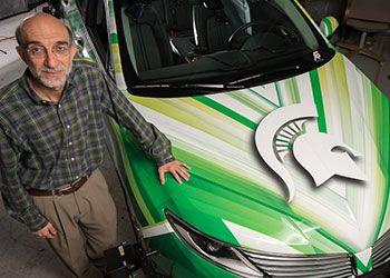 hayder radha poses with MSU's autonomous car