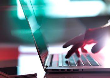 Hand using computer