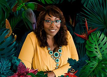kinitra brooks surrounded by lush flowers