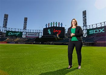 Courtney Cawley Gray, B.A. '04, Eli Broad College of Business, in a room overlooking white sox stadium
