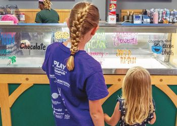 Kids look at the array of Dairy Store ice cream flavors