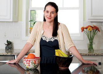 Science writer, Sheril Kirshenbaum poses in kitchen