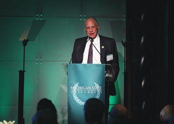 Edward J. Minskoff stands at podium