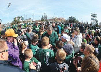 Coach Mark Dantonio signs autographs for fans
