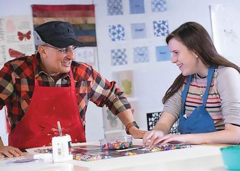 Elle Morgan, a blind student, feels her way through art class
