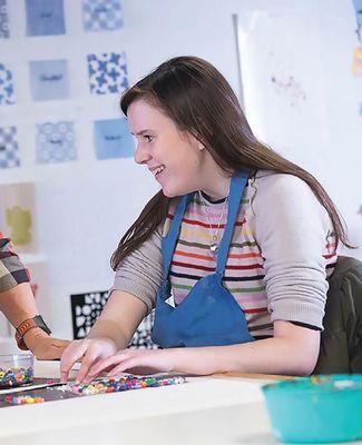 Elle Morgan, a blind student, feels her way through art class