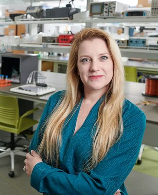 Professor Galit Pelled poses in her lab