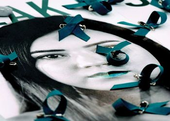 Teal ribbons lie on top poster
