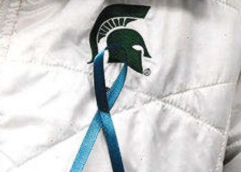 teal ribbon on jacket with Spartan Helmet