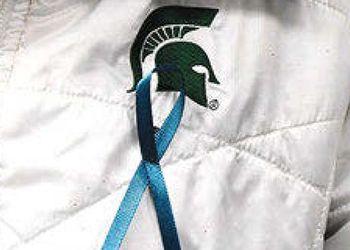 teal ribbon on jacket with Spartan Helmet