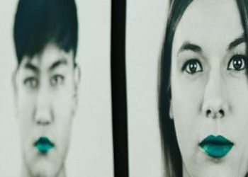 Students with lips painted teal from the student speak up campaign