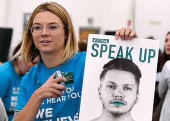 MSu student holding speak up poster