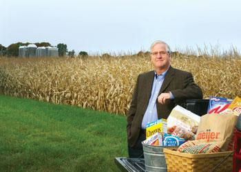 David Closs, the John H. McConnell Endowed Chair, poses with some of the food products that have benefited from the work of MSU's #1 ranked program in supply chain management in the Eli Broad College of Business.