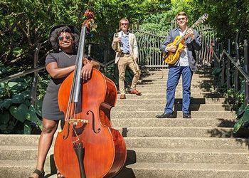 Spartan Jazz Trio pose on Beal garden steps.