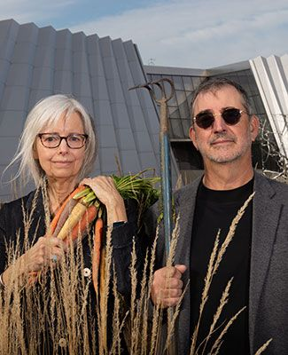 dave giordan and cindy lounsbery pose in a parody of the American Gothic painting