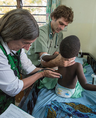 Terry Taylor conducting a medical examination on a child