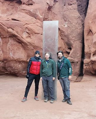 Spartans stand in front of Utah monolith