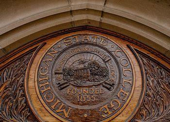 University seal engraved in wood.