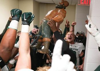 Paul Bunyan trophy hoisted by MSU Football team