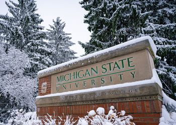MSU Campus sign covered in snow