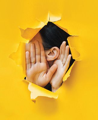 Person with hands to hears to hear better