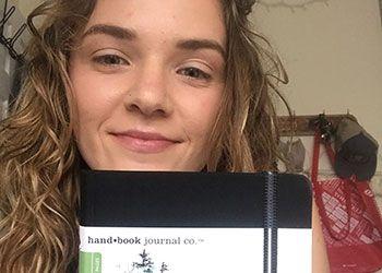 Melissa Gordon, holding a sketchbook