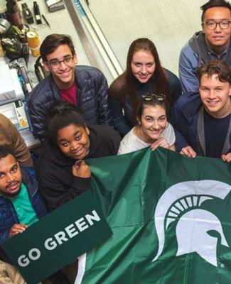 CAL students hold Spartan helmet flag