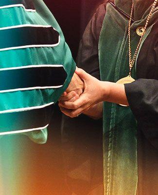 faculty investiture handshake