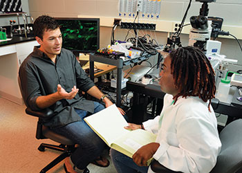 Dr. Brian Gulbransen and a student in the lab