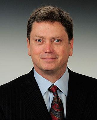 A formal portrait of alumnus Craig Rogerson.