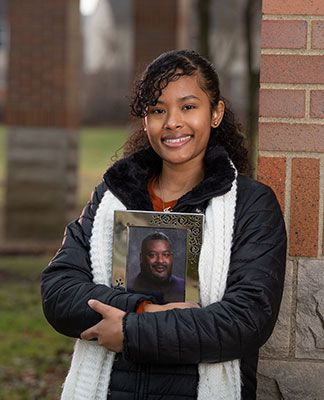jessica wright holds a photo of her father