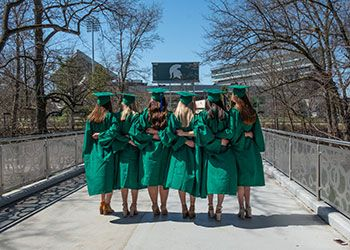 MSU graduates at the library bridge