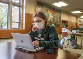 Student with mask studying