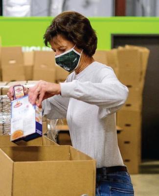 Calhoun County Spartan packing food boxes